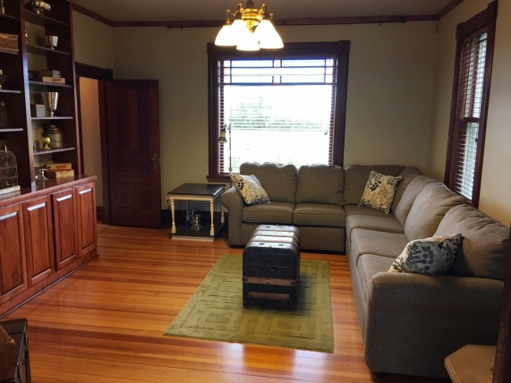 Main floor family room. Couch pulls out to bed. Pocket doors shut to dining room.