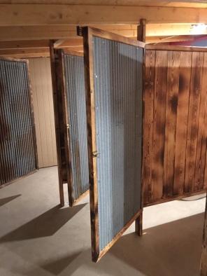 Tin doors on women's bathroom
